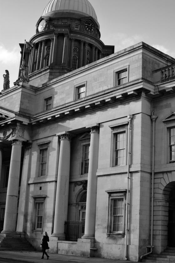 Lady walks past the Custom's House Dublin