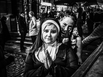 Young lady dresses up as a Nun in Dublin's Temple Bar for Halloween
