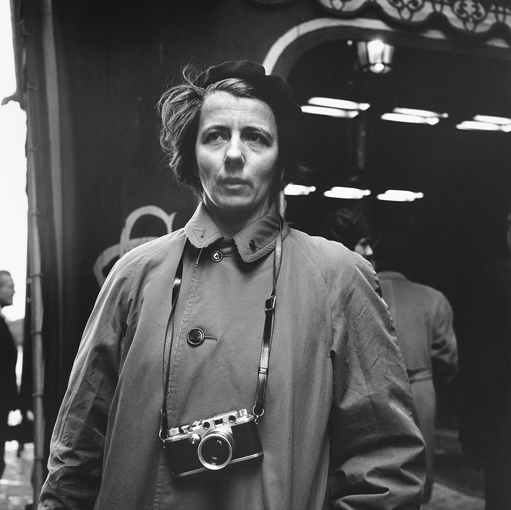 Vivian Maier poses for a black and white photo