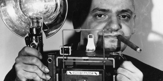 WeeGee posing for a photo with his camera