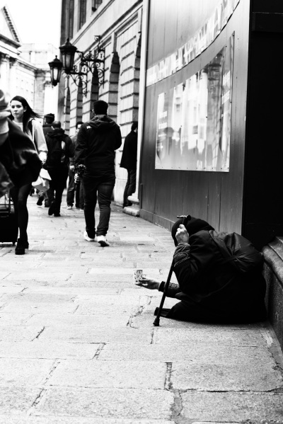 A homeless woman begs on the street in Dublin Ireland