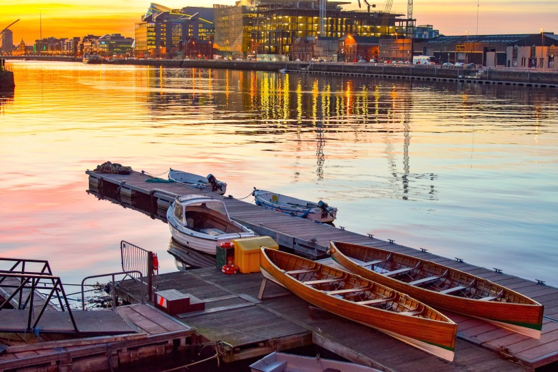 Boats sit on the edge of the River Liffey in Dublin Ireland
