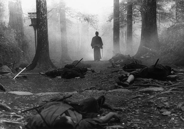 A scene from the film Seven Samurai where the Samurai walks from a forest after defeating his many foe