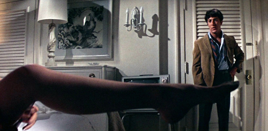 Dustin Hoffmann stands at the doorway in the famous seduction scene in The Graduate