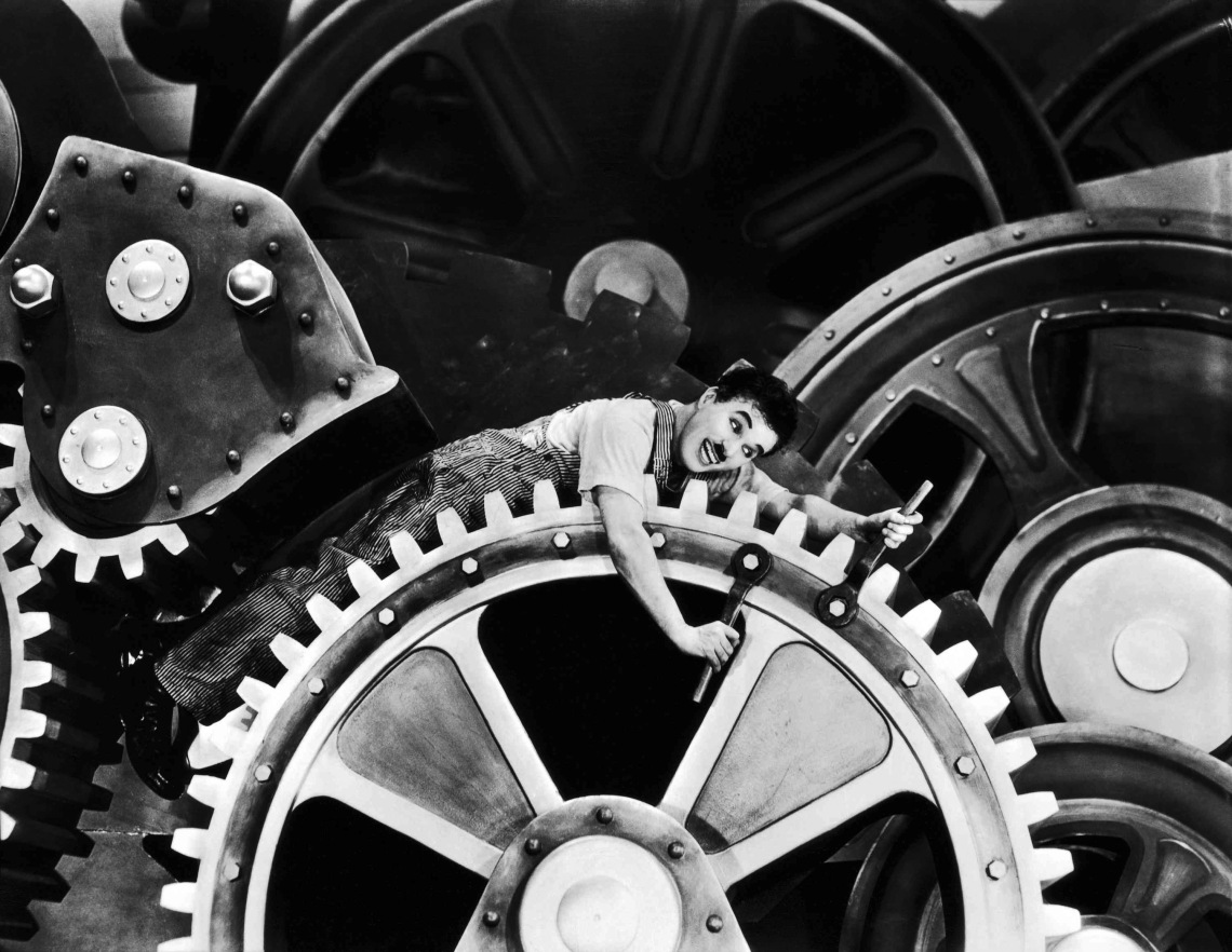 Charlie Chaplin lies on clock wheels in his masterpiece modern times