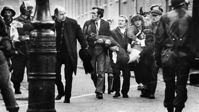 Jack Duffy is carried after being the first shot dead on Bloody Sunday